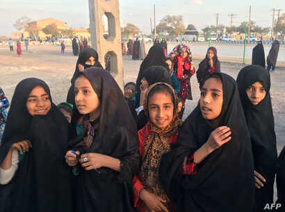 Afghan refugee girls gather at the Bardsir settlement for Afghan refugees in Kerman province, Iran, Oct. 22, 2016.