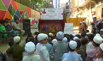 Children watch a puppet show organized by Thespianz Theatre that teaches inter-faith harmony, in the Lyari neighborhood, Karachi, Pakistan.