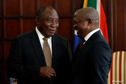 FILE - South African President Cyril Ramaphosa, left, talks with Deputy President David Mabuza in Pretoria, May 28, 2019.