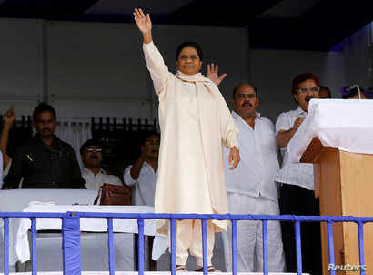 The Bahujan Samaj Party (BSP) chief Mayawati waves to her supporters during an election campaign rally on the occasion of the death anniversary of Kanshi Ram, founder of BSP, in Lucknow, India, Oct. 9, 2016.