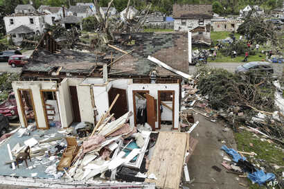 Repair and cleaning efforts begin on a neighborhood damaged by a tornado storm system that passed through the area, destroying homes and cutting off access to utilities, May 29, 2019, in Dayton, Ohio.