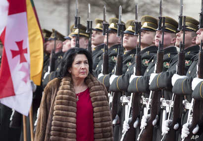 \Georgia's President Salome Zourabichvili reviews the honor guard during a welcome ceremony at the Presidential palace in Vilnius, Lithuania, March 7, 2019.