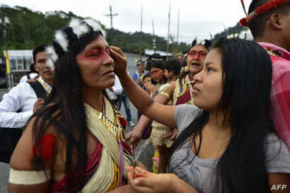 A Waorani indigenous woman gets makeup on during a demonstration against the exploitation of oil in their territory in Puyo, Ecuador, April 11, 2019.