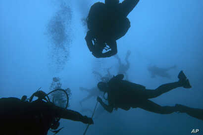 Divers visit a 5th Century B.C. shipwreck, the first ancient shipwreck to be opened to the public in Greece, including to recreational divers who will be able to visit the wreck itself, near the coast of Peristera, Greece, April 7, 2019.