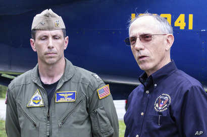 Base Commander Captain Mike Connor, commanding officer NAS Jacksonville and NTSB Vice Chairman Bruce Landsberg, right, speak about a plane crash, May 3, 2019, at a news briefing at the front gate of Naval Air Station in Jacksonville, Fla., Saturday.
