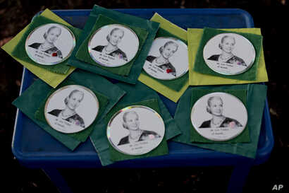 Souvenirs of Eva Peron are displayed for sale on a table at a square in Los Toldos, Argentina, May 6, 2019.