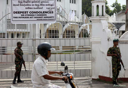 Soldiers stand guard outside the Grand Mosque, days after a string of suicide bomb attacks on churches and luxury hotels across the island on Easter, in Negombo, Sri Lanka, April 26, 2019.