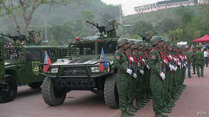 UWSA soldiers stand at attention during ceremonies on April 17 in Phangsang, Shan state, Special Region 2. (Am Sandford/AsiaReports)
