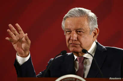 Mexico's President Andres Manuel Lopez Obrador gestures during a news conference at the National Palace in Mexico City, Mexico, April 15, 2019.