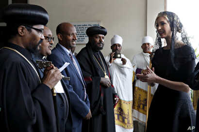 White House senior adviser Ivanka Trump, right, arrives for a ceremony at Holy Trinity Cathedral honoring the victims of the Ethiopian Airlines crash, Monday April 15, 2019, in Addis Ababa, Ethiopia.