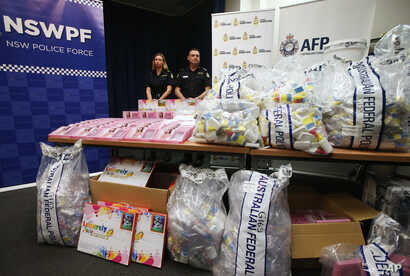 FILE - Officers stand by a display of confiscated drugs in Sydney.