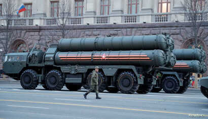 A Russian serviceman walks past S-400 missile defense systems in central Moscow, Russia, April 29, 2019.