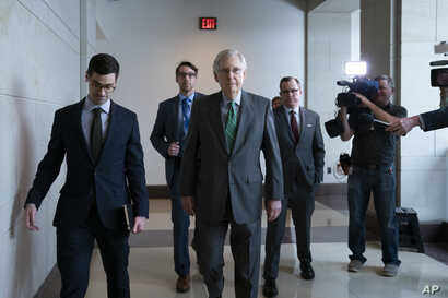 Senate Majority Leader Mitch McConnell, R-Ky., passes reporters as he and other congressional leaders head to a classified briefing on Iran after members of both parties asked for more information on the White House's claims of rising threats in the ...