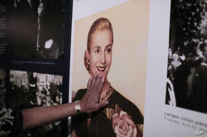 "A woman touches a picture of Eva Peron on display at the home-turned-museum ""Casa Museo Eva Perón"" in Los Toldos, Argentina, May 6, 2019."