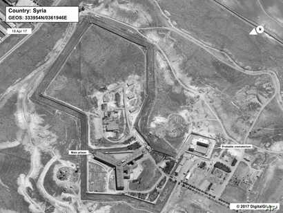 FILE - This April 18, 2017 satellite image provided by the State Department and DigitalGlobe, shows what the State Department described as a building in a prison complex in Syria that was modified to support a crematorium.