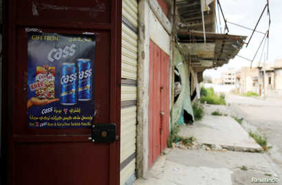 Advertising sign is seen at a liquor shop, after it was banned during the Islamic State militants' seizure of the city, in Mosul, Iraq, April 18, 2019.