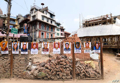 Portraits of victims are seen at the reconstruction site of Kathmandu Durbar Square which was damaged by a 2015 earthquake, on the fourth anniversary of the disaster in Kathmandu, April 25, 2019.