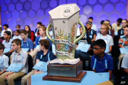 The Scripps National Spelling Bee trophy sits in front of competitors during the second round, May 28, 2019, in Oxon Hill, Md.