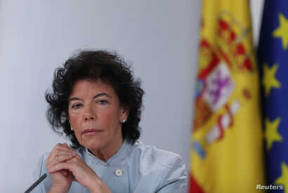 FILE - Spain's Isabel Celaa gestures during a news conference after a cabinet meeting at the Moncloa Palace in Madrid, Spain, June 8, 2018.