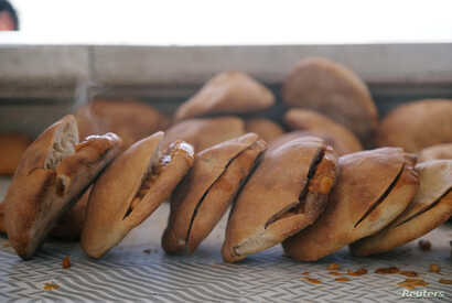 FILE - Bean sandwiches are ready for sale at a restaurant in Benghazi, Libya, April 29, 2019.