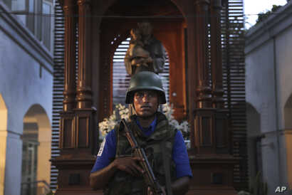 A Sri Lankan soldier stands guard at the damaged St. Anthony's Church or Shrine in Colombo, Sri Lanka, April 26, 2019.