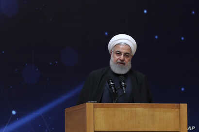 """In this photo released by the official website of the office of the Iranian Presidency, President Hassan Rouhani speaks during a ceremony commemorating """"National Day of Nuclear Technology,"""" in Tehran, Iran, April 9, 2019."""