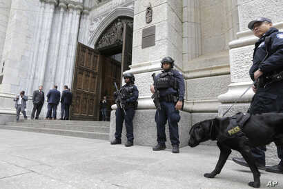 A larger-than-usual security presence is seen at St. Patrick's Cathedral in New York, April 18, 2019.