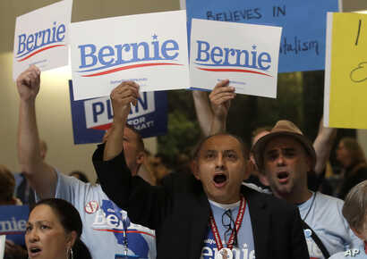 Supporters of Democratic presidential candidate Sen. Bernie Sanders, cheer during the 2019 California Democratic Party State Organizing Convention in San Francisco, June 2, 2019.