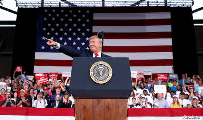 U.S. President Donald Trump reacts with supporters during a campaign rally in Panama City Beach, Fla., May 8, 2019.