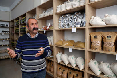 Tunceli Mayor Mehmet Macoglu from the Communist Party of Turkey (TKP) is seen at the Ovacik cooperative store in Tunceli, Turkey, April 15, 2019.