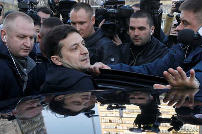 FILE - Ukrainian presidential candidate and comedian Volodymyr Zelenskiy gets into a car after undergoing a drugs and alcohol test, which is a precondition to participate in a policy debate ahead of the second round of a presidential election, outsid...