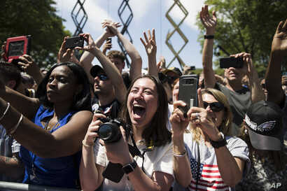 Attendees cheer as Democratic presidential candidate Joe Biden arrives at a campaign rally at Eakins Oval in Philadelphia, May 18, 2019.