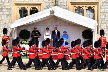 FILE - U.S. President Donald Trump and first lady Melania Trump stand with Britain's Queen Elizabeth on the dais in the Quadrangle at Windsor Castle, Windsor, Britain July 13, 2018.