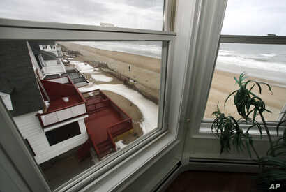 The view out the window of an oceanfront condo in Salisbury, Mass., Feb. 15, 2019. Academic researchers say concerns over rising sea levels and increased flooding have sapped more than $15 billion in appreciation from homes along the Eastern Seaboard...