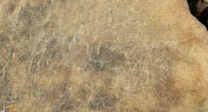 """Engraved Cherokee syllabary inscription from 1.5km into Manitou Cave is signed, """"Richard Guess,"""" believed to be the son of Cherokee syllabary inventor Sequoyah, also known as George Guess or Gist."""