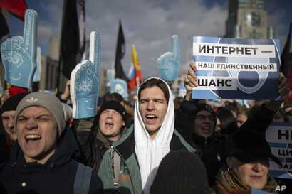 """Demonstrators rally against a bill that envisions an independent Russian internet, essentially cutting users from the global web, in Moscow, Russia, Sunday, March 10, 2019. The placard on the right says """"The internet is our only chance."""""""