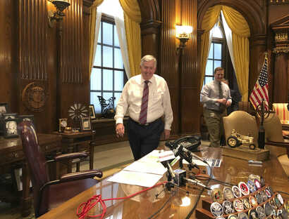 Missouri Gov. Mike Parson arrives for a news conference in his Capitol office in Jefferson City, Missouri, May 14, 2019. Parson voiced support for an abortion ban bill on Wednesday.
