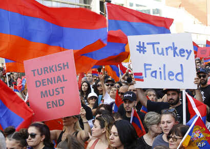 Huge crowds of Armenian Americans march during an annual commemoration of the deaths of 1.5 million Armenians under the Ottoman Empire in Los Angeles, April 24, 2019.