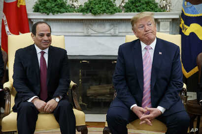 President Donald Trump meets with Egyptian President Abdel Fattah el-Sisi in the Oval Office of the White House, April 9, 2019, in Washington.