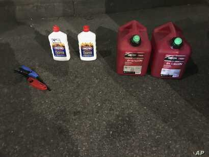 This photo posted on the New York Police Department's Twitter page shows gas cans and lighter fluid that a New Jersey man was seen carrying as he entered St. Patrick's Cathedral in New York, April 17, 2019.