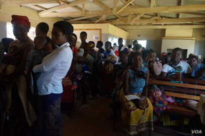 Mothers queue to have their children vaccinated against malaria at Likuni Community Hospital in Lilongwe, Malawi.