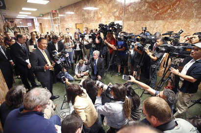 FILE - San Francisco Public Defender Jeff Adachi, left, talks to members of the media after Francisco Sanchez' arraignment in San Francisco, July 7, 2015. Adachi died in February.
