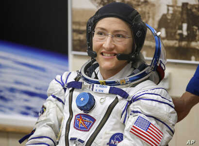 FILE - U.S. astronaut Christina Koch, member of the main crew of the expedition to the International Space Station (ISS), looks on prior the launch of Soyuz MS-12 space ship at the Russian leased Baikonur cosmodrome, Kazakhstan, March 14, 2019.