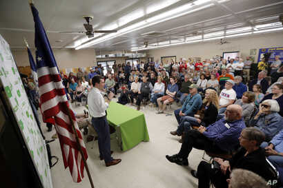 2020 Democratic presidential candidate South Bend Mayor Pete Buttigieg speaks during a town hall meeting in Fort Dodge, Iowa, April 16, 2019.
