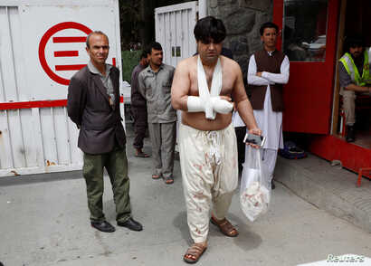 A man injured in a blast leaves a hospital after treatment in Kabul, Afghanistan, May 8, 2019.