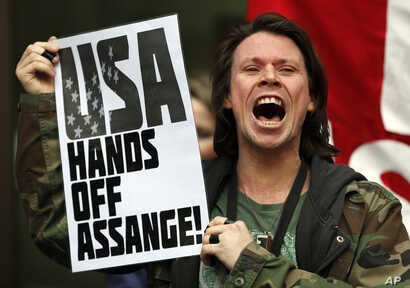 British activist Lauri Love protests at the entrance of Westminster Magistrates Court in London, May 2, 2019. WikiLeaks founder Julian Assange is facing a court hearing over a U.S. request to extradite him for allegedly conspiring to hack a Pentagon ...