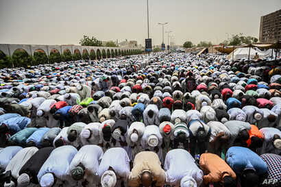 Sudanese protesters attend a Friday prayer outside the army headquarters in the capital Khartoum, April 19, 2019.