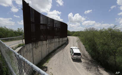 U.S. Customs and Border Patrol patrol along the border fence, June 27, 2018, in Hidalgo, Texas.