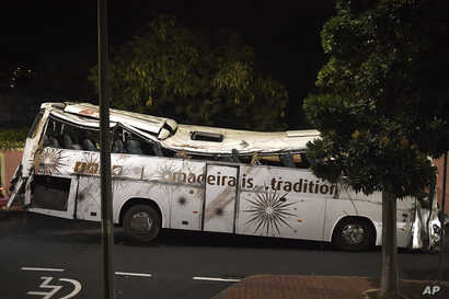 The tour bus involved in a fatal crash is seen at Canico, on Portugal's Madeira Island, April 18, 2019.