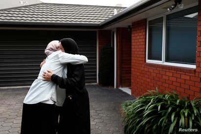 Zahra Fathy, widow of 70-year-old Hussein Moustafa, an Egyptian immigrant who lost his life in the Christchurch shootings, embraces a neighbor in Christchurch, New Zealand March 30, 2019.